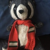 Stuffed Raccoon with Red Scarf