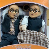 Elderly couple porcelain dolls.