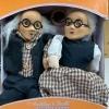 Elderly couple porcelain dolls.