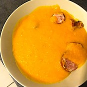 The creamy soup with sausage pieces.