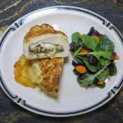 The finished chicken breast with a salad.