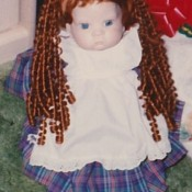 A doll with long red curly hair.
