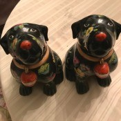 Two black dog figurines.
