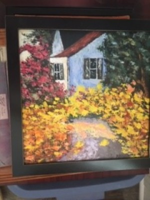 A painting with yellow and pink flowers.
