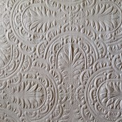 A white textured wallpaper.