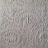 A white textured wallpaper.