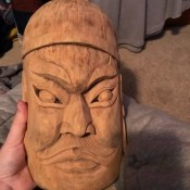 A wooden face mask.