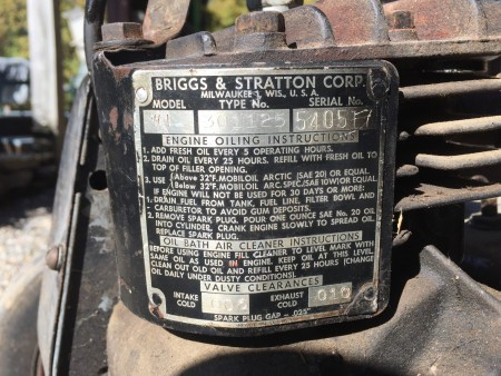 The manufacturer information on a vintage self propelled mower.