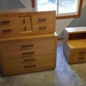 An old fashioned dresser and nightstand.