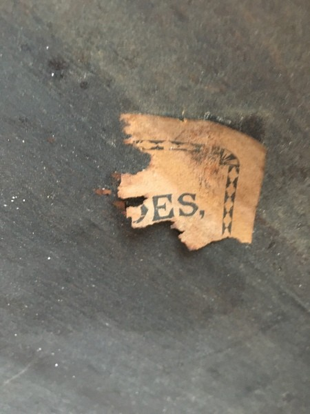 An old worn marking on a table.