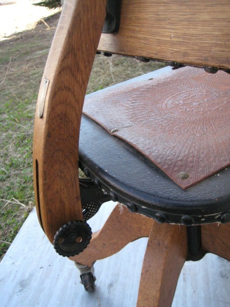 The back of a wooden office chair.