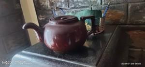 A ceramic pot with a lid.