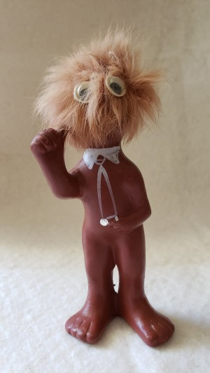 A figurine with a hairy head.