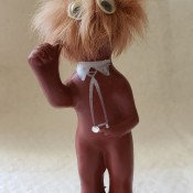 A figurine with a hairy head.