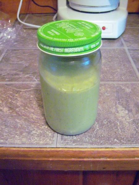 A jar of avocado dressing.