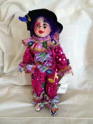 A colorful clown porcelain doll.