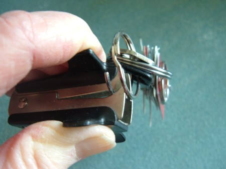 A staple remover used to open a key ring.