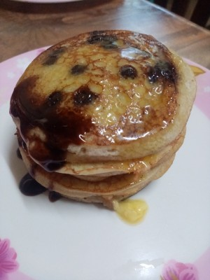 A stack of pancakes with syrup.