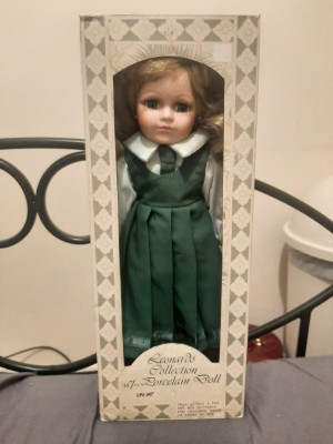 A doll in a green dress, still in the original box.