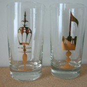 Drinking glasses with gold emblems.