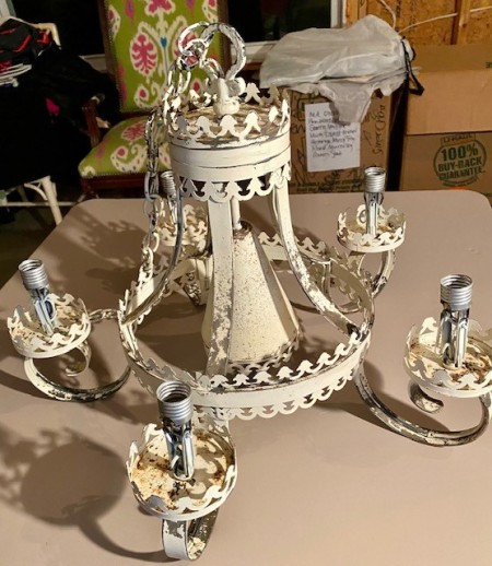 An old cream colored chandelier.