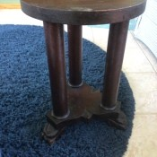 A small end table with three legs.