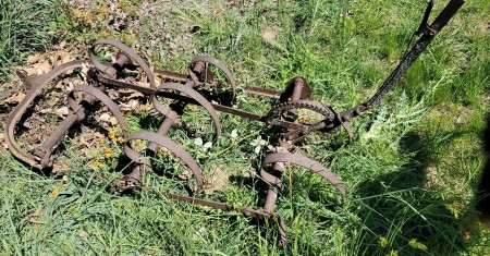 A old piece of farm equipment.