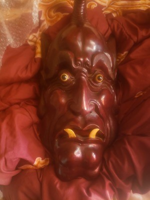 A large wooden mask.