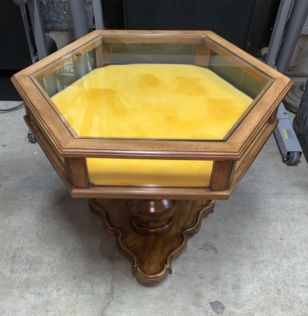 A Brandt display top table with yellow fabric inside.