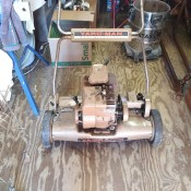 An old gas powered Yardman reel mower.