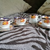 A collection of fine china with painted flowers.
