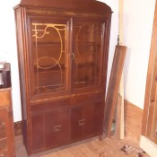 A vintage cabinet with ornate doors.