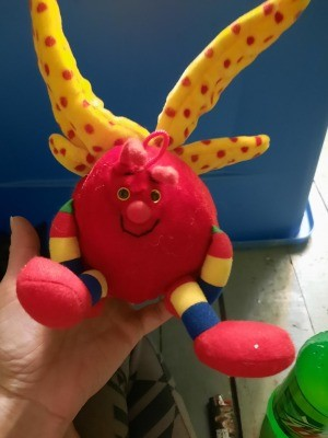 A brightly colored stuffed toy.