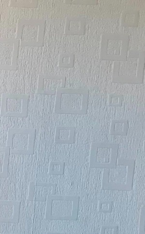 A white wallpaper with geometric designs.