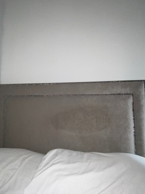 A stain on a suede headboard.