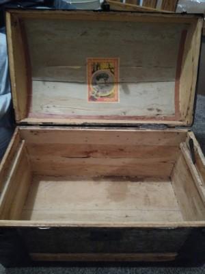 An open steamer trunk.