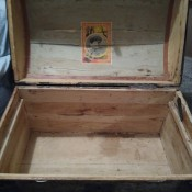 An open steamer trunk.