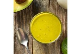 A batch of avocado dressing in a jar.