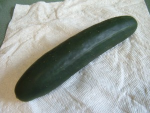 A cucumber on a paper towel.