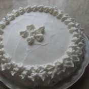 Finishing the cake with whipped cream.