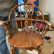 The wooden rocking chair from the front.