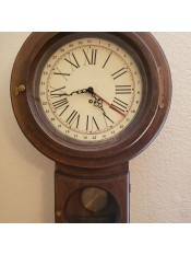 An old wall clock with a pendulum.