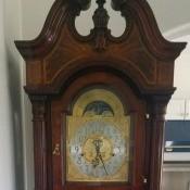 A tall grandfather clock.