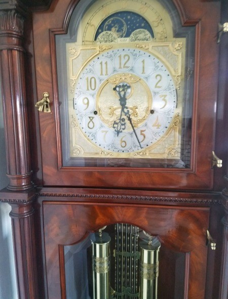 A close up of a grandfather clock.