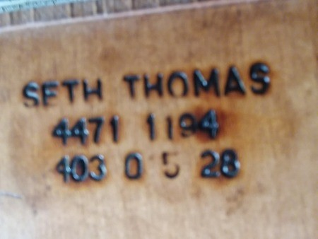 Markings on the back of the clock.
