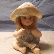 A small porcelain figurine.