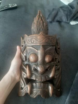 A decorative wooden mask.
