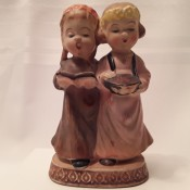 A figurine of two girls.