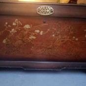 A Lane cedar chest with painted flowers.