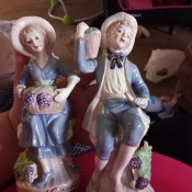 Two old fashioned figurines of a young man and woman.